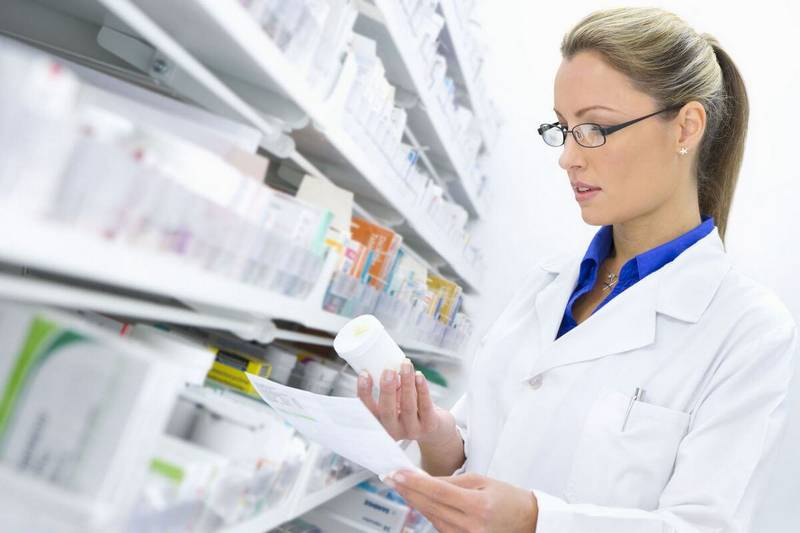 woman checking the label of pills